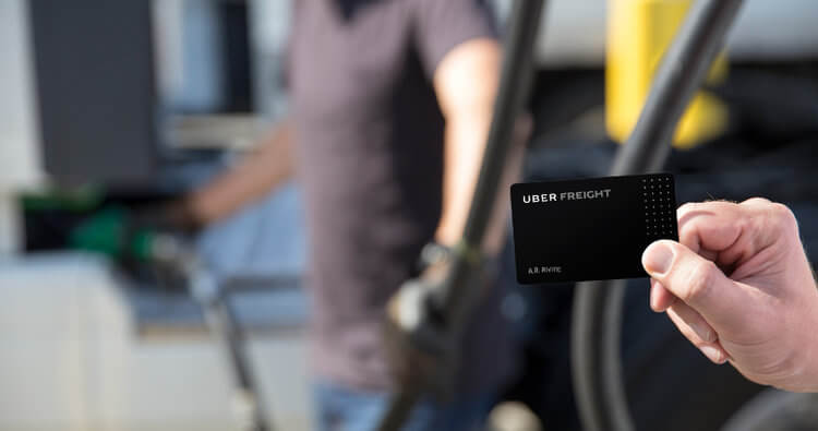 Trucker using the Uber Freight fuel card to book a load