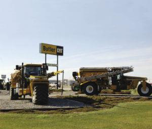 Butler tractors in field