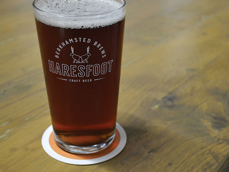 Haresfoot Brewery's new brand identity shown on their pint glasses