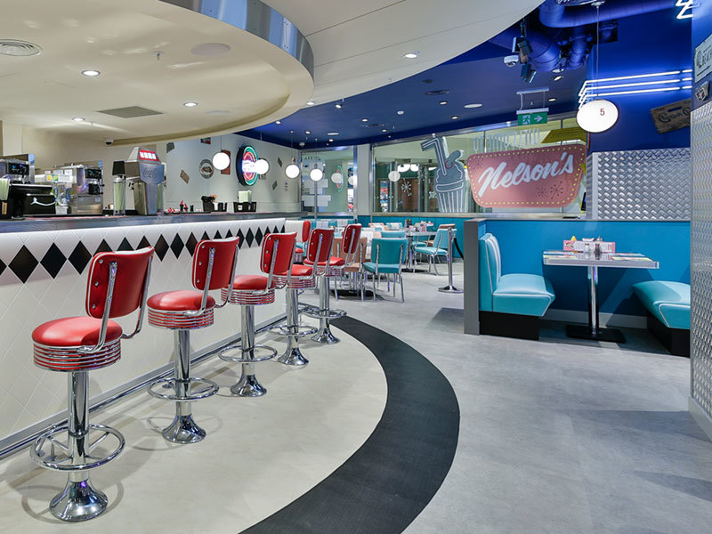 Raised seating in authentic 1950s restaurant designed by Prosper