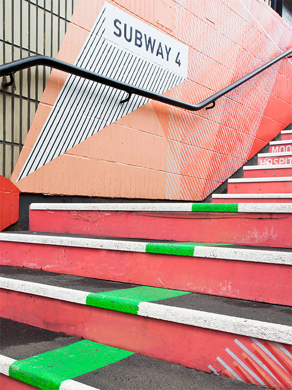 Subway staircase vibrant wayfinding designed by Prosper