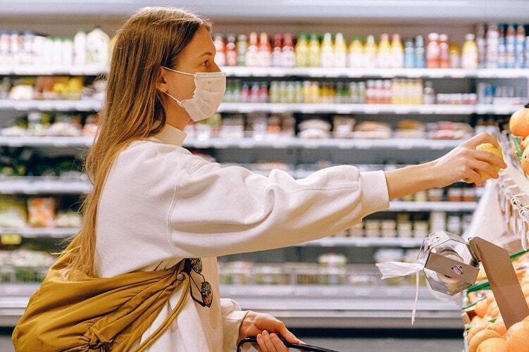 Woman wearing mask in supermarket 500 min