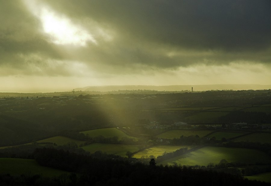 Shaft of light over Dewerstone on Dartmoor