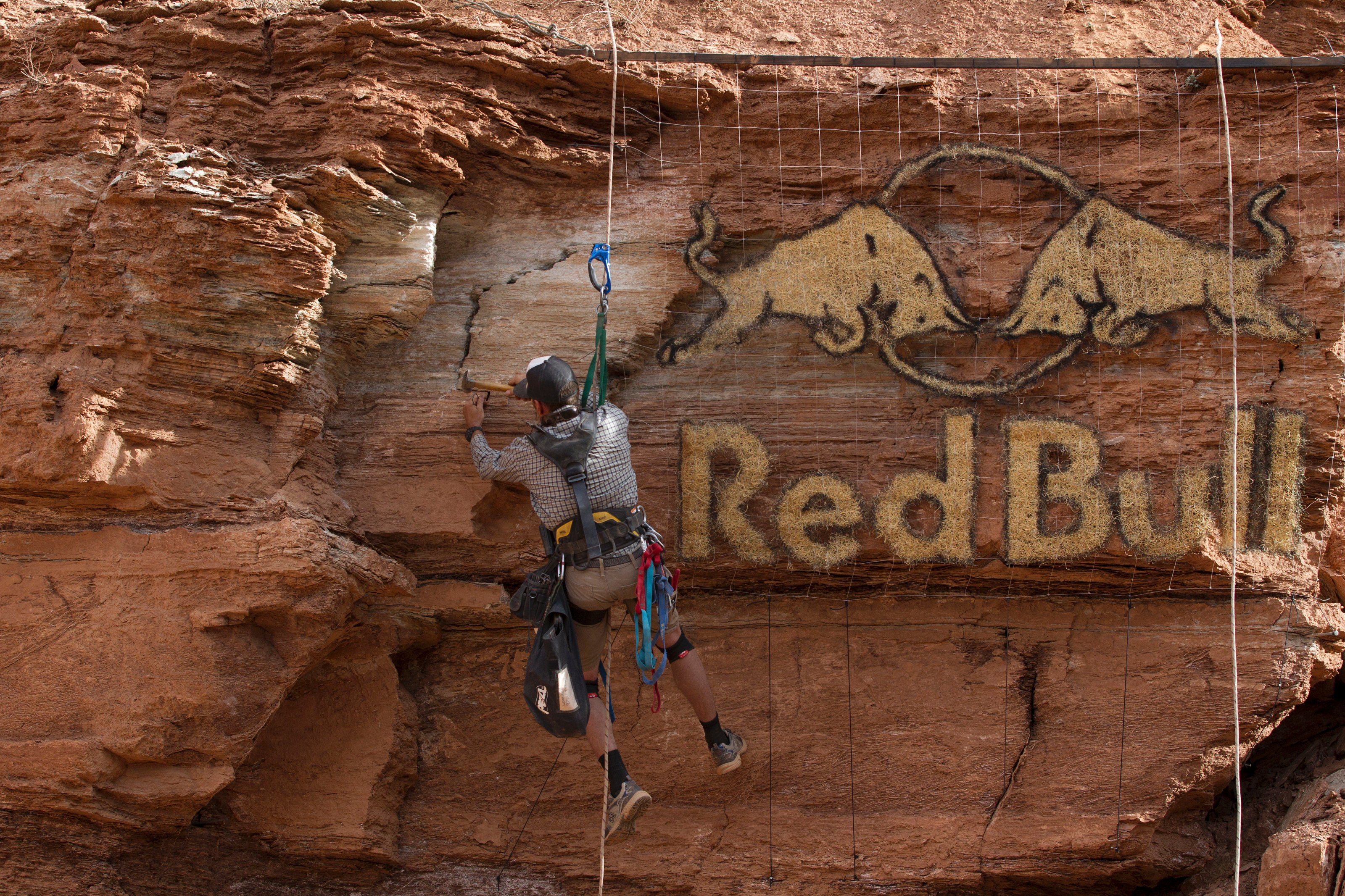 A course worker puts up a banner at Red Bull Rampage, in Virgin, UT, USA, on 9 October, 2013. // John Gibson/Red Bull Content Pool // P-20131010-00015 // Usage for editorial use only // Please go to www.redbullcontentpool.com for further information. //