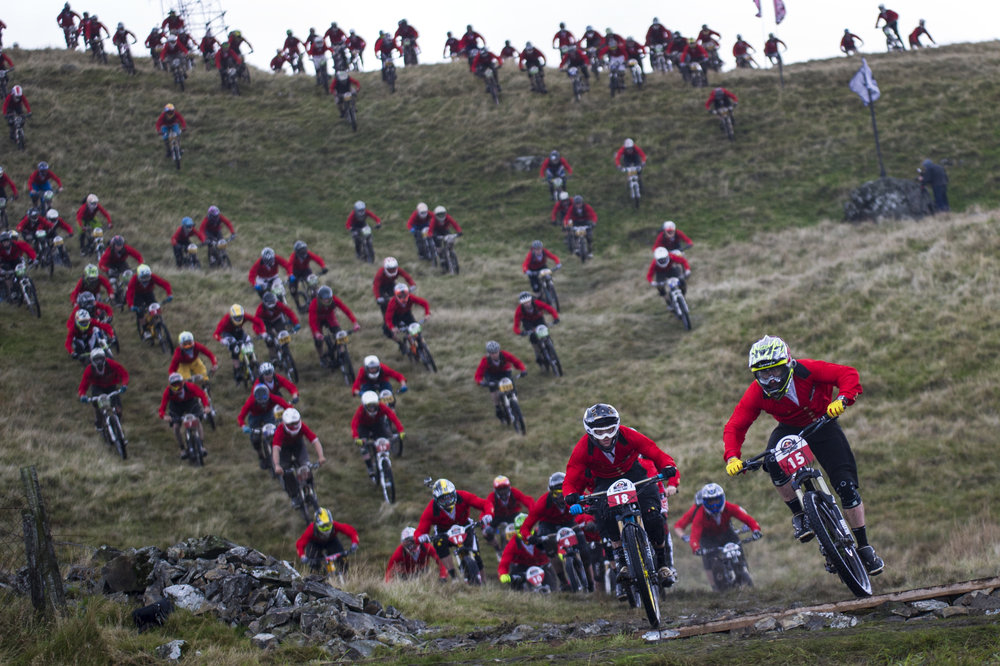 Competitors perform during the Red Bull Fox Hunt on Slieve Martin in Rostrevor, Northern Ireland on October 6, 2013.