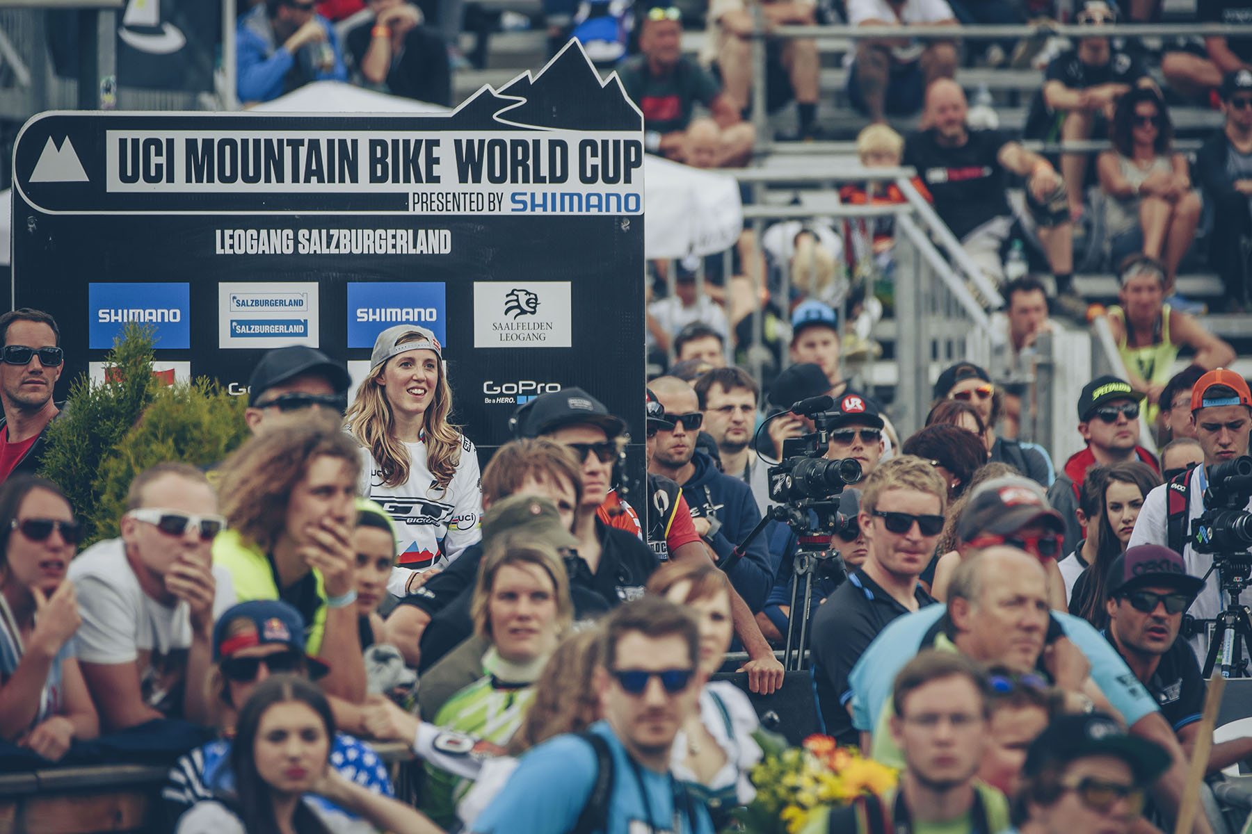 Rachel Atherton looks on nervously from the hot seat, anticipating Manon's first split time, was she up or down?