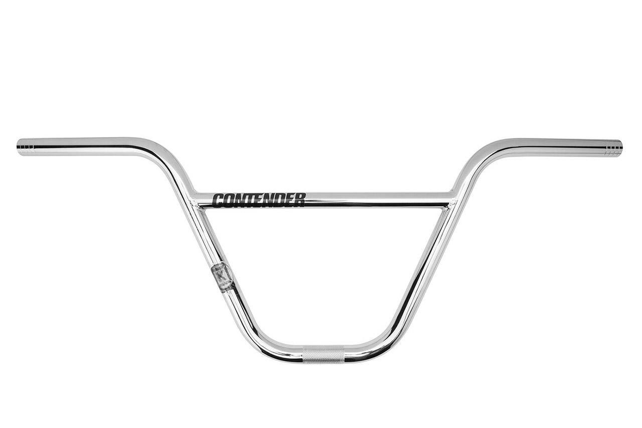 Der Contender, Don Collers Signaturelenker von Kink BMX, ist ideal für größere Fahrerinnen und Fahrer. Um ihn so leicht wie möglich zu machen, ist der Lenker mehrfach gebuttet und wurde nach dem Schweißen für mehr Stabilität außerdem hitzebehandelt. Höhe: 9,75''; Breite: 29,5'' (inklusive Markierungen zum Kürzen auf 29'', 28.5'', 28'' oder 27,5''; Upsweep: 1°; Backsweep: 12°; UVP: 79,99 EUR