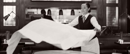 Waiter Setting Table at The Delaunay