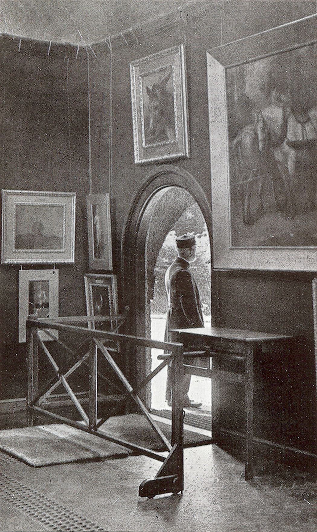 Old Photo of G F Watts standing outside the Gallery, shot from the interior view.