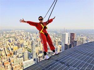 Defying gravity doing the Edgewalk on the CN Tower,Toronto