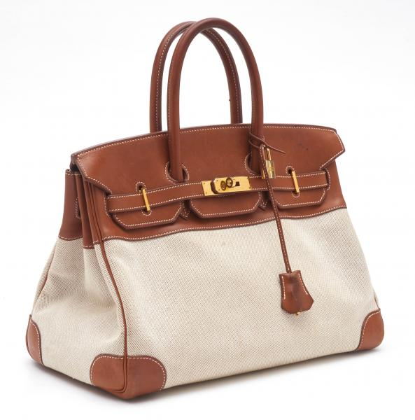 HERMÈS PARIS MADE IN FRANCE  - 1999.  - A Birkin BAG 35 cm in light Toile H and [...]