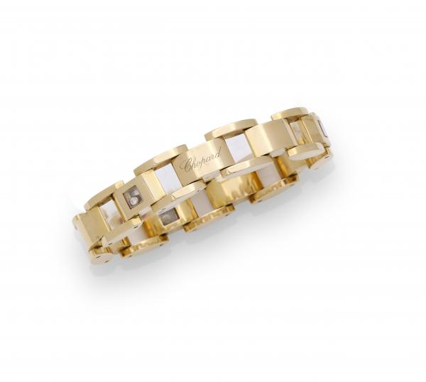 CHOPARD «Happy Diamond», vers 2010 Bracelet en or jaune 18K (750/1000), composé de [...]