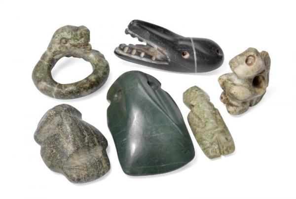 Six pendants of jade and flint in the form of fish head, insect, face and snake. [...]