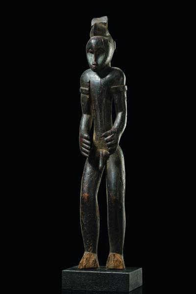 Standing male figure  - Côte d'Ivoire, Senufo  -   - wood, black[...]
