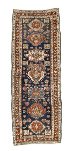 An antique Karadja runner, North West Persia. Centre with a wide range of geometrical [...]