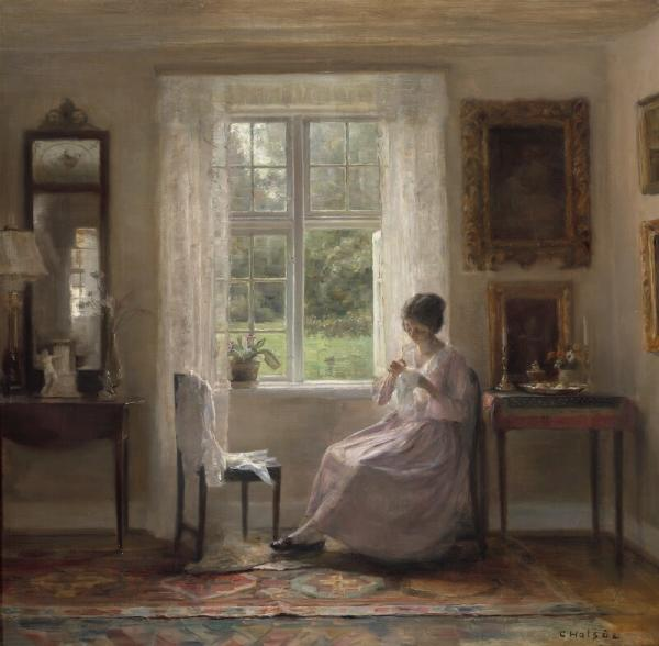Carl Holsøe: Interior with the artist's wife sitting with her needlework next to an [...]