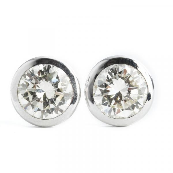 A pair of diamond ear studs each set with a brilliant-cut diamond weighing a total of [...]