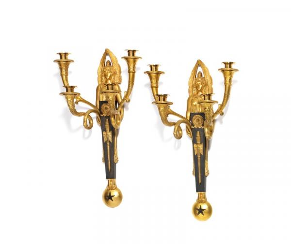 A pair of large Empire style gilt and patinated bronze four-light wall lights adorned [...]
