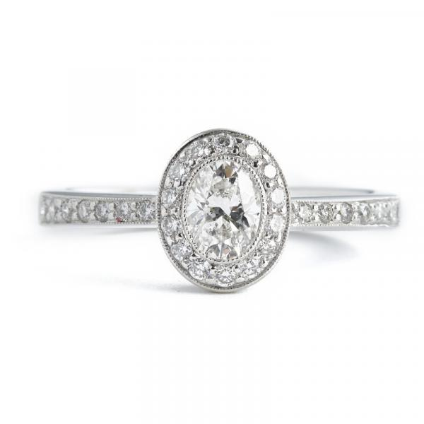Hartmann's: A diamond ring with an oval-cut diamond weighing app. 0.42 ct. encircled [...]