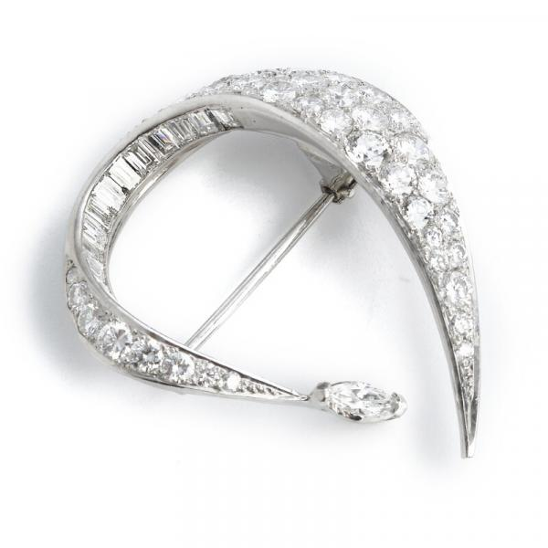 Georg Jensen & Wendel: A diamond brooch set with brilliant and baguette-cut diamonds, [...]