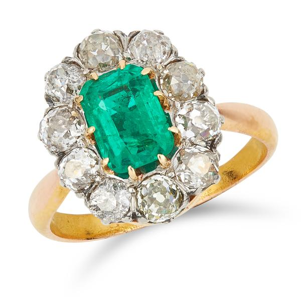 ANTIQUE COLOMBIAN EMERALD AND DIAMOND CLUSTER RING set with an emerald cut emerald of