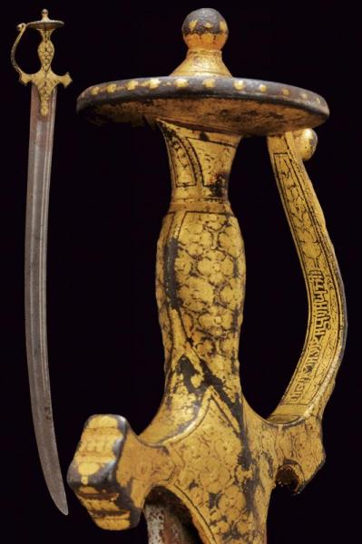 A Sikh tulwar - dating: circa 1800  - provenance: India, Wide and long, curved, [...]