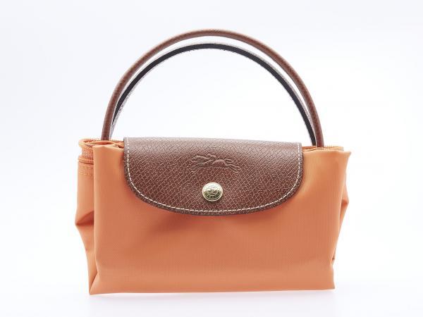 LONGCHAMP, Sac pliage en toile orange et cuir marron. 20 x 30 cm ...