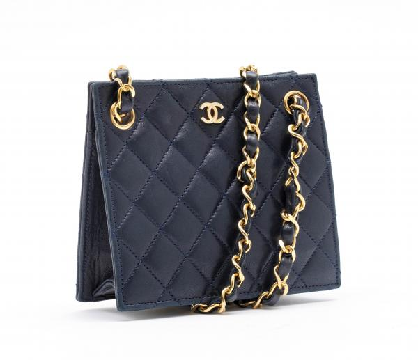 CHANEL  - 1986–88.  - A SHOULDER BAG Mini made of dark blue quilted lamb leather. [...]