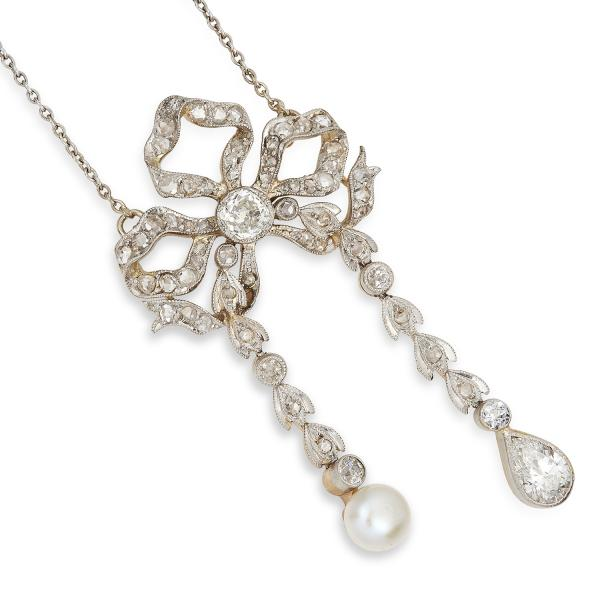 ANTIQUE EDWARDIAN PEARL AND DIAMOND LAVALIER BOW PENDANT set with a pearl and old, [...]