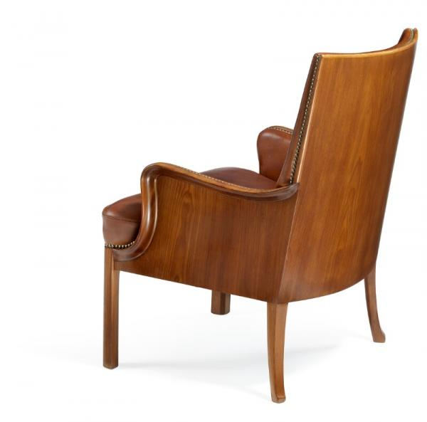 Frits Henningsen: Armchair with profiled Cuban mahogany frame with curvy armrests and [...]