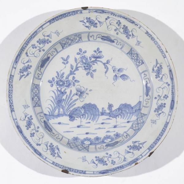 A FAIENCE PLATE  - Delft, early 18th century.  - With blue decoration in East Asian [...]