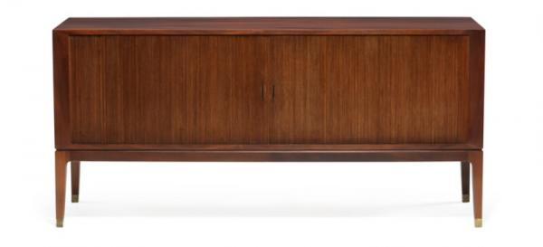 Danish cabinetmaker: Mahogany sideboard on tapering legs with brass