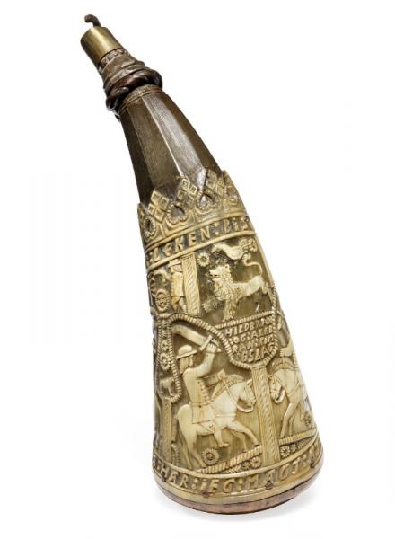 A finely carved Norwegian powderhorn dated 1771 decorated with figures and [...]