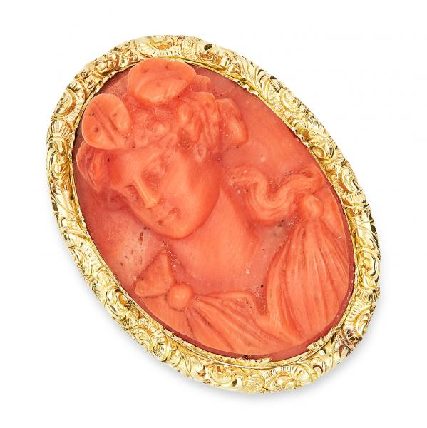 ANTIQUE CARVED CORAL CAMEO RING, 19TH CENTURY set with an oval carved coral cameo [...]