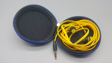 Gelbe In-Ear Kopfhörer mit Behälter