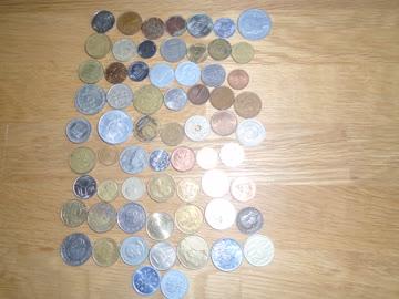 65 Ausländische Münzen wert unbekannt