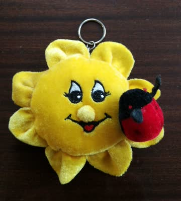 Plüsch-Sonne mit Glückskäfer