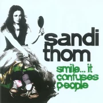 Thom Sandi - Smile...It Confuses People