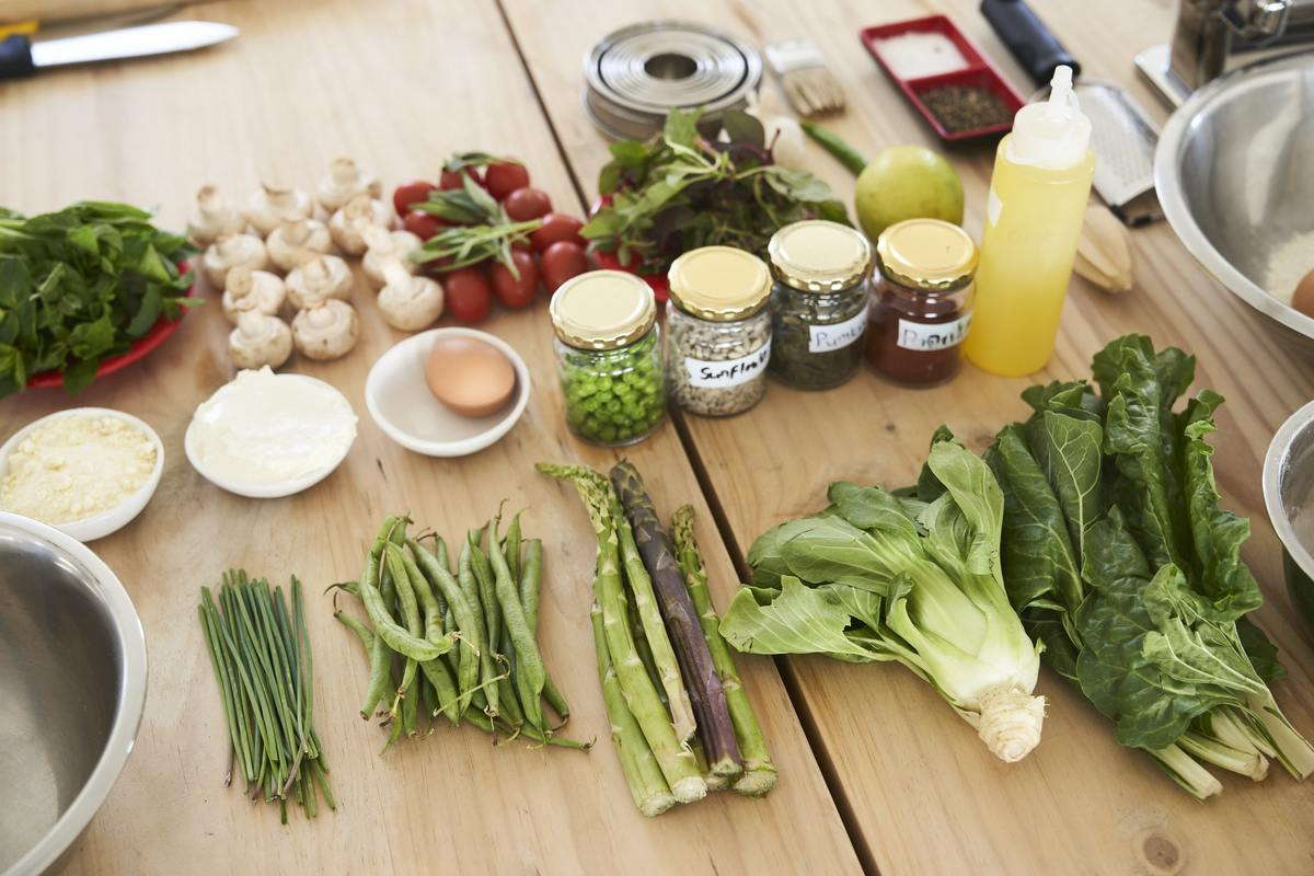 A table full of fresh vegetables and other ingredients