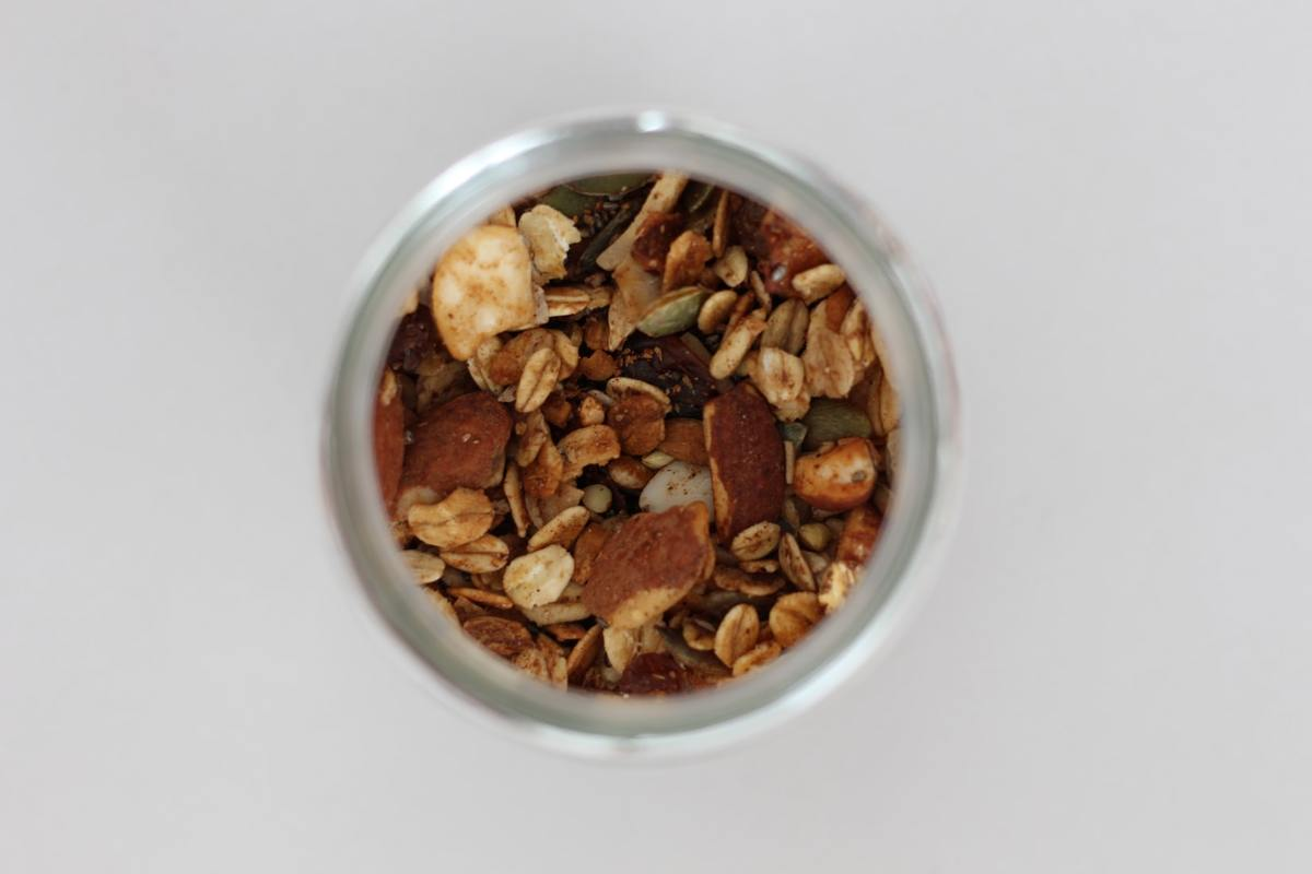 A jar of nuts, seeds and oats