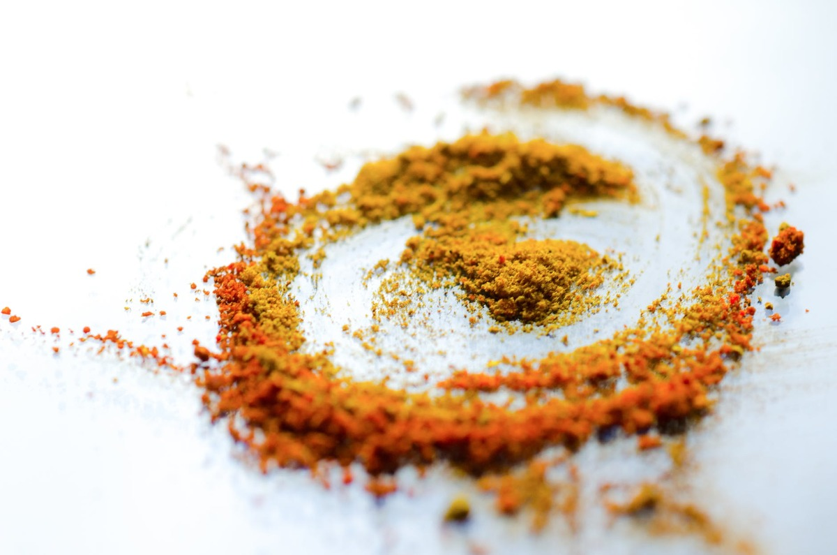 Curry powder arranged in a swirl on a surface