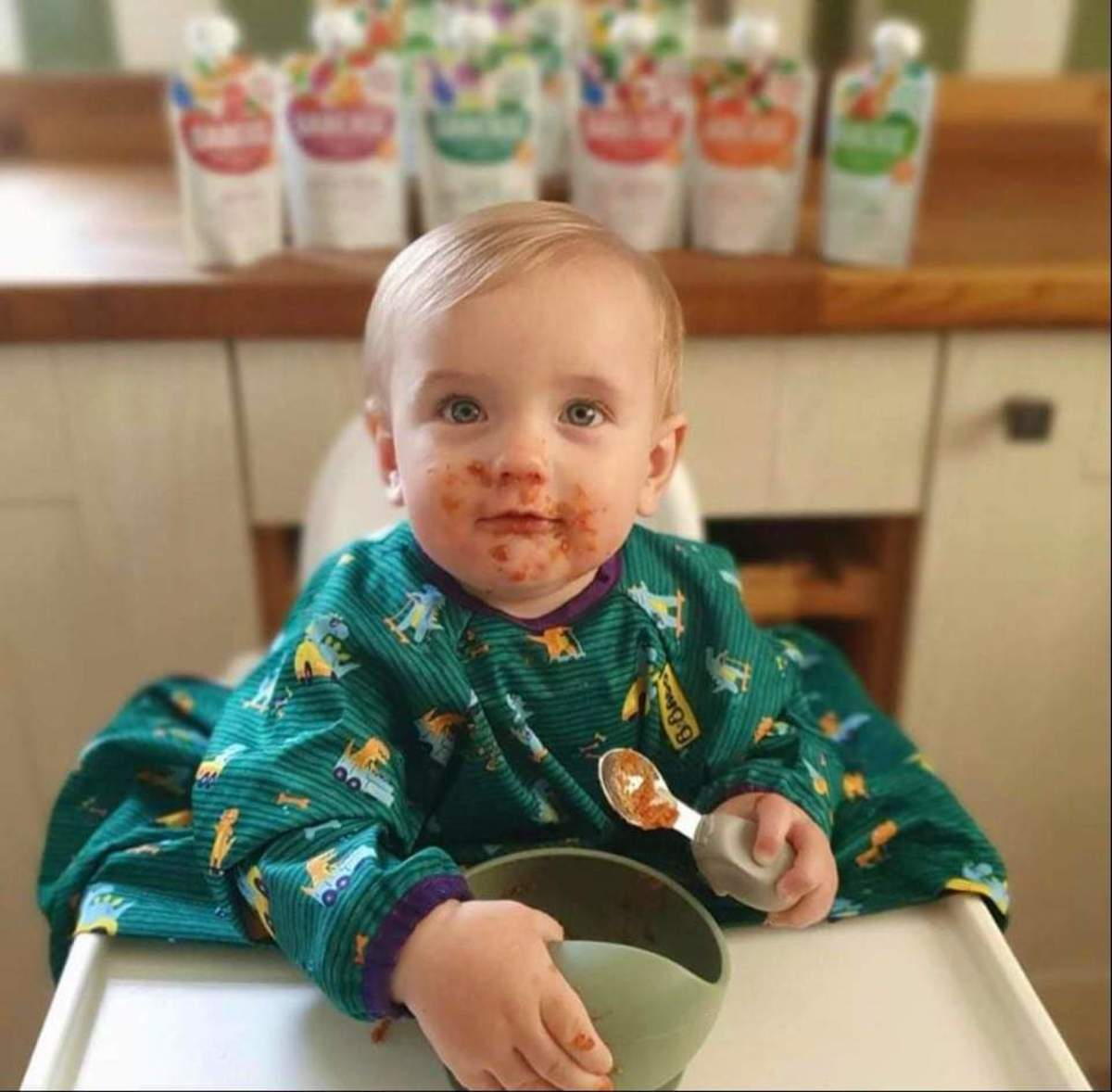 A weaning baby eating milk free food