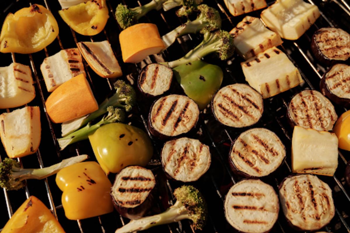Aubergine, pepper and broccoli slices on a barbecue