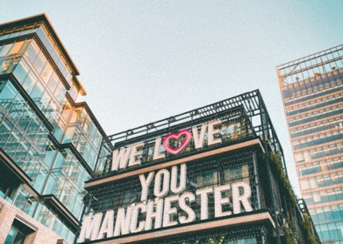 A building with lights that read 'We love you Manchester'
