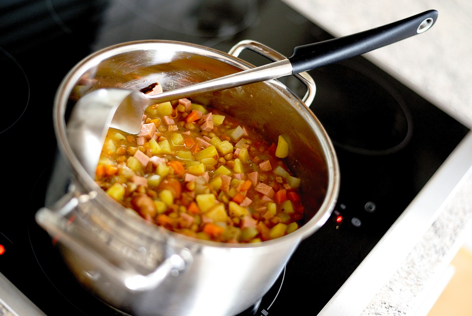 A chicken and lentil stew in a saucepan