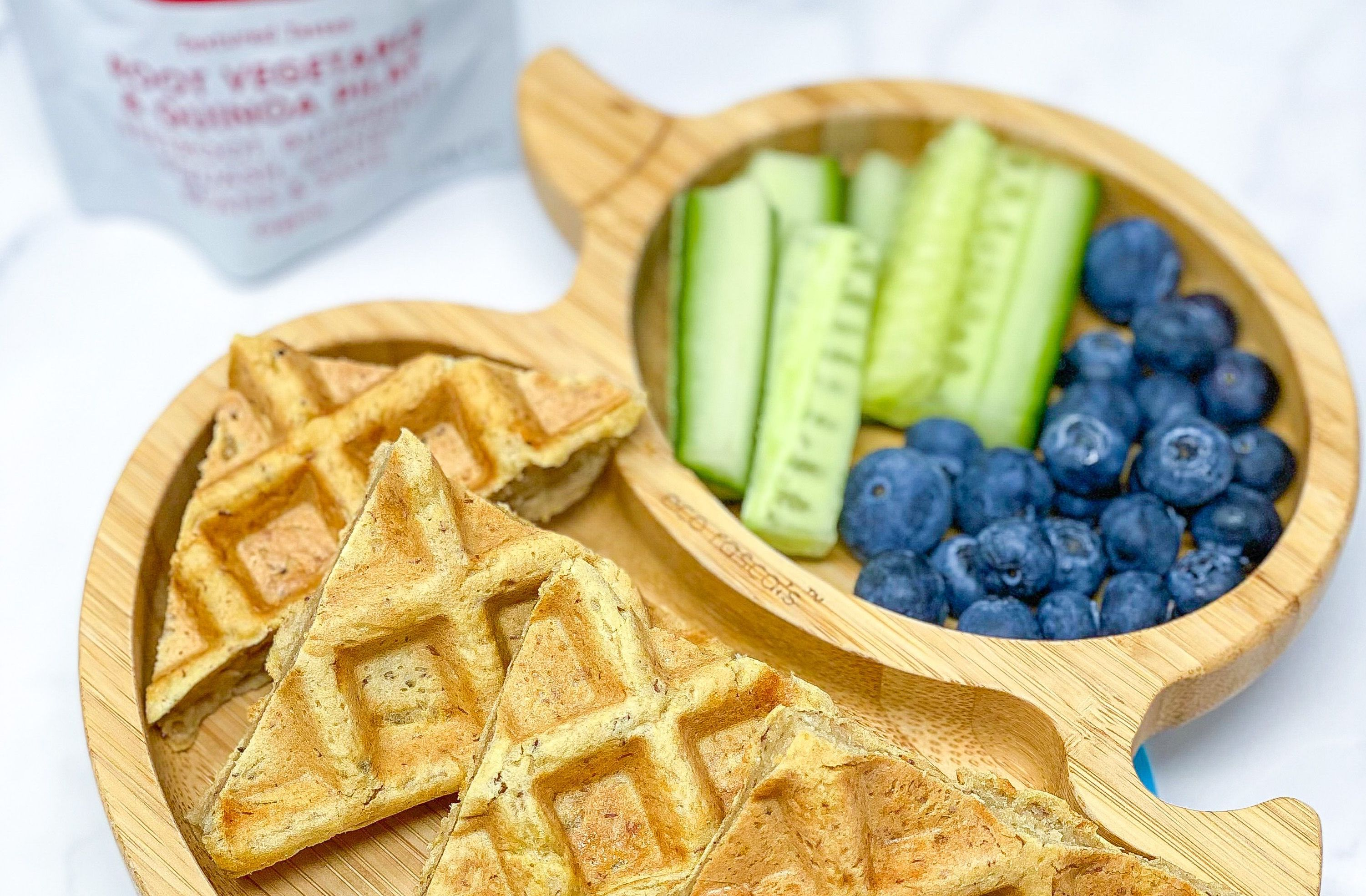 Triangles of Babease savoury waffle on a plate with fruit and vegetables