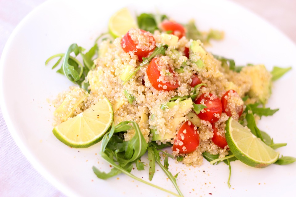 Colourful vegetable quinoa for baby weaning served with lime