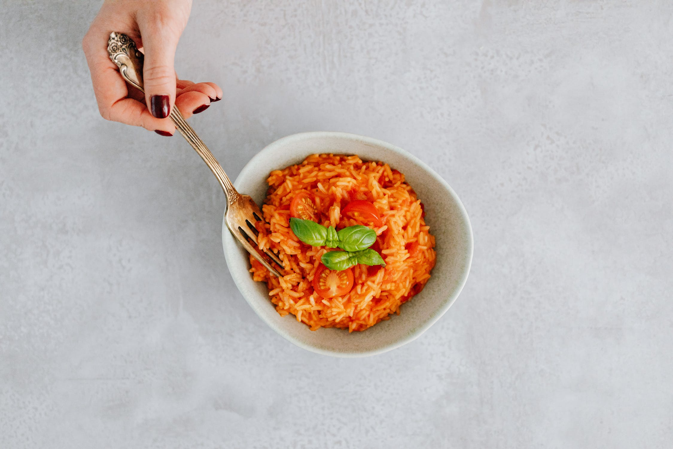 A creamy risotto with tomatoes on top