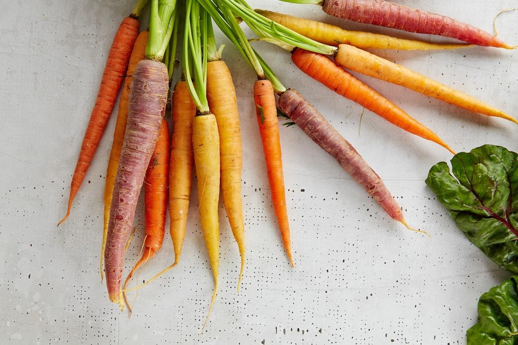 Organic carrots of various colours