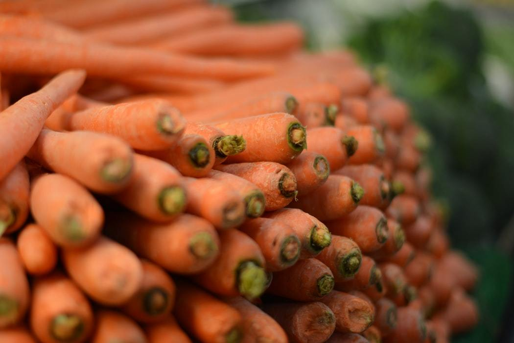 Organic carrots stacked on each other